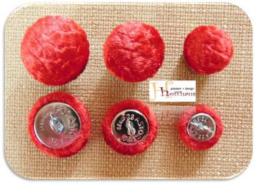 Cushion buttons red shimmering